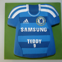 Chelsea Football Shirt Cake Here is a cake that I made for a Chelsea fan's birthday. The cake was a 12 inch vanilla square carved with a template that I had made...