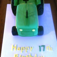 Tractor Cake Tractor cake for my brother's 17th birthday, chocolate with chocolate icing, covered in homemade mmf