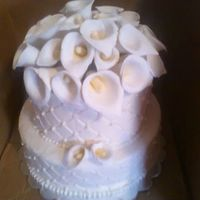 Wedding Cake With Calle Lilly Topper Buttercream frosting with diamond pattern and called lilly topper