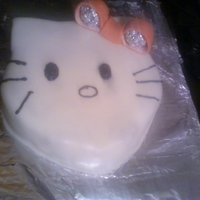 Hello Kitty Strawberry cake with MMF. for a 5 yr old girl's birthday Yes, the aluminum foil was removed before serving lol!