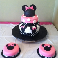 Minnie Mouse Cake tier cake wtih fondant, ribbon, and edible glitter