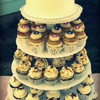 Wedding Cupcake Tower Wedding cupcakes topped with a cutting cake for the bride & groom