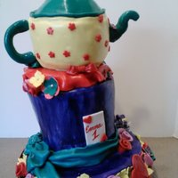 Alice In One-Derland For A First Birthday Party This was my first attempt at topsy turvy cake. I think I should've made the teapot lean a little more, but I was scared to make it...