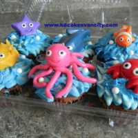 Ocean Cupcakes Buttercream water and MMF creatures. There's a matching cake to go along with this. Here's the CC link http://cakecentral.com/...
