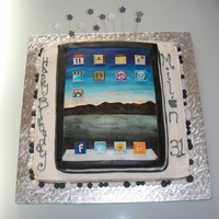 Ipad Cake   My 1st fondant cake ..... the ipad was covered with fondant and hand painted. The cake below is chocolate with buttercream.
