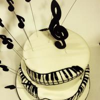 Piano Cake *2 tier piano cake. Chocolate cake with chocolate ganache. Fondant accents