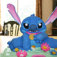 Disney's 'stitch' Cake This cake was made using the Wilton 3D bear cake pan. The bear was augmented using rice treats to make Stitch. Fondant covers the body. The...