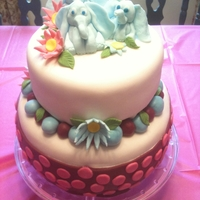 Girl's Elephant Themed Birthday Cake Marshmallow fondant covered 2 tiered cake with marshmallow fondant elephants and accents.