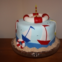 Sailboat Cake I totally copied this idea from another cake on cake central. Simple 1 tier cake with buttercream and marshmallow fondant. I used vanilla...