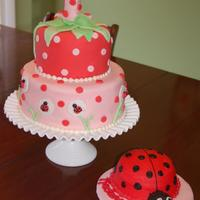 Ladybug/strawberry Cake  This was a white chocolate almond cake with cherry almond filling, white chocolate swiss meringue buttercream and fondant. I made the 1...