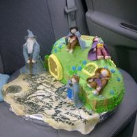 Lord Of The Rings Cake  This is a LOTR themed cake with Fondant figurines. This was a quick request from a friend while I was visiting out of town, so the whole...