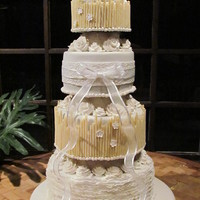 White Wedding Cake  German Chocolate cake with coconut pecan filling, iced in ganache and covered in fondant. First and third tiers are covered with white...