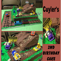 Construction Site Birthday Cake Construction Site cake for my grandson 2nd birthday.Yellow cake with buttercream frosting. He loves trucks and trains so I used all his...