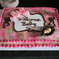 Pink Camoflauge Baby Shower Cake Pink Camoflauge cake with fondant bow and fondant baby in a chocolate basket. The inside of the cake was camoflauge also.