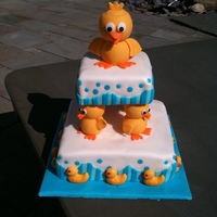 My Version Of Bath Time Ducks   Two tier, Vanilla cake with Fresh strawberies and vanilla pudding, completely covered with Fondant