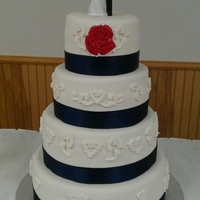 Simple And Elegent Classic white almond with sweet buttercream covered in fondant with a hand painted red rose