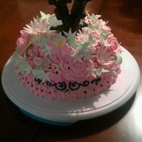 Sweet 16 White Chocolate cake covered in butter cream and tons of flowers.
