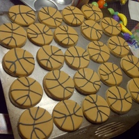 Basketball Cookies shortbread cookies covered in fondant to look like basketballs.