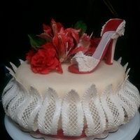 Red Shoe All made from gum paste and fondant. White Velve cake with raspberry puree and Italian butter cream filling