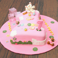 First Birthday All fondant except for blocks....Baby dressed as a lamb with baby teddy next to her
