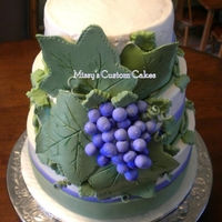 Tuscan/grapes & Leaves Wedding Cake Grapes and leaves made out of gumpaste. 3 tier french vanilla cake with Raspberry liqueur mouse filling between multiple layers. Cake is...