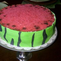 Watermelon Cake Strawberry cake with chocolate chips and fresh strawberries and cream cheese in the middle layer