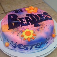 Beatles Cake  I made this for my moms Birthday. It didn't come out the way I wanted it to but my mom liked it. I used the duff edible sprays and it...