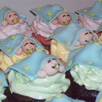 Baby Shower Cupcakes   These are fondant babies. I think they really turned out cute. Hope this is an inspiration.