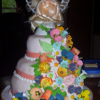 My First Flower Cake I made this cake for my in-laws 50th wedding anniversary. I just learned how to make gumpaste flowers, and never had stacked cakes like...