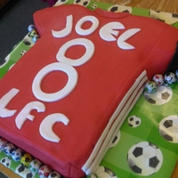 Liverpool Fc 8Th Birthday Cake The birthday boy wanted a liverpool cake with a captains armband and that's exactly what he got!