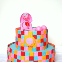 Patchwork Cake Ptchwork cake with different patterns. The bunny on top is the birthday girl's favorite stuffed animal.Thanks for looking
