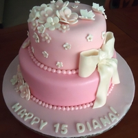 A Pink 15Th Birthday Fondant cake with gumpaste flowers