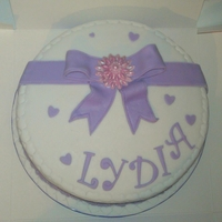 Purple Bow Birthday Cake Made with very specific instructions to this design. All Sugarpaste decoration
