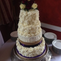"Four Tiered Wedding Cake Covered In Buttercream Roses Bottom Tier Is A 12 Lemon Cake With Lemon Buttercream Filling Middle Two Tiers Are Four tiered wedding cake covered in buttercream roses. Bottom tier is a 12"" lemon cake with lemon buttercream filling; middle two..."