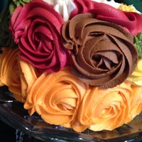 "Thanksgiving/fall Themed Cake 6"" Spiced Carrot Cake with cream cheese filling. Roses done in buttercream using 1M tip."