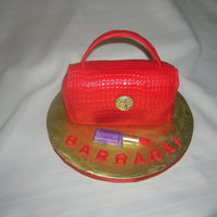 Red Purse Chocolate cake covered with fondant, chocolate lipstick.