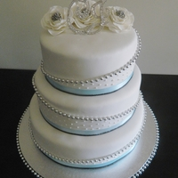 Baby Blue, Black And Silver All choc for a choc lover, beads and ribbon non edible, gumpaste flowers with silver centre.