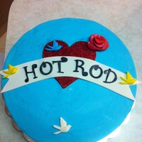 Tattoo Inspired Cake Red velvet cake with BC and fondant/gumpaste pieces.