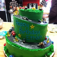 Mario Kart Cake   Decorations made from modeling chocolate, and the cake frosted in buttercream!