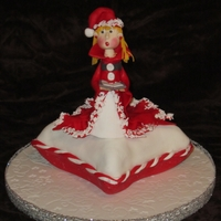 Christmas Carol's Pillow cake covered in Fondant. Girl on top made out of Fondant and Gumpaste