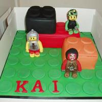 Lego Brick Cake With Lego Figures Lego.brick cake with Lego army.soldier,roman soldier and Lord of the Rings orc