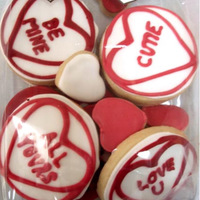 Valentine Cookies Sugar cookies decorated with royal icing. Love hearts with messages.