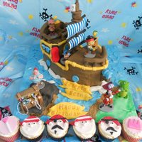 Jake And The Neverland Pirates Jake and the Neverland pirates cake and matching cupcakes for pirate and princess party
