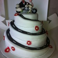 Spiral Wedding Cake With Gerberas And Motorbike Spiral wedding cake with gerberas and motorbike