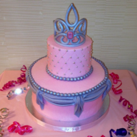 Pink And Silver Princess Cake Buttercream with fondant drapes and pearls made using Wilton baroque mold. Silver dragees and gumpaste crown with jewel from Wilton gem...