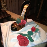 Gum Paste Shoe Gum Paste Shoe with Gum paste roses on a drum draped with Fondant brushed with pearl dust