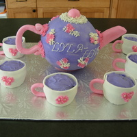 Tea Pot And Tea Cups Tea Pot made from sports ball pan covered in BC icing, gum paste handle and spout and tea cup handles. Tea cups are cupcakes surrounded by...