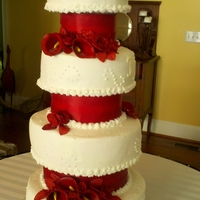 Jereice And Ramone 7 tiers with 3 dummies and 4 cake. All buttercream with gumpaste roses, callas, and orchids. Stacked with SPS and transported with...