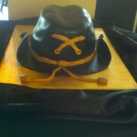Mac Groom is in the Army Calvary. Chocolate cake with buttercream under fondant with gumpaste decor. Cake was a surprise to groom from bride.