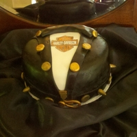 Ramone Groom is into Harley's. Red velvet cake with buttercream underneath fndant with gumpaste decor and edible image.